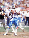 Houston Oilers Warren Moon (1) in action during a game against the San Diego Chargers on September 30, 1990 at Jack Murphy Stadium in San Diego California.The Oilers beat the Chargers 17-7. Warren Moon was inducted to the Pro Football Hall of Fame in 2006.