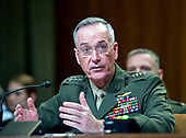 """The Chairman of the Joint Chiefs of Staff, United States Marine Corps General Joseph F. Dunford, Jr., testifies at a US Senate Committee on Appropriations Subcommittee on Defense hearing entitled """"A Review of the Budget & Readiness of the Department of Defense"""" on Capitol Hill in Washington, DC on Wednesday, March 22, 2017.<br /> Credit: Ron Sachs / CNP"""