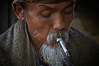 Old man smoking Newspaper,Bali Indonesia