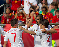 Spain forward Alvaro Negredo (22) celebrates his goal with teammates. In a friendly match, Spain defeated USA, 4-0, at Gillette Stadium on June 4, 2011.