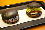 Burger King launches to its menu two kinds of black burgers &quot;Kuro Diamond&quot; and &quot;Kuro Pearl&quot; which contains black buns and black cheese made from bamboo charcoal, garlic sauce made with squid ink and beef patties made with black pepper all in black color starting on Friday, September 19 for a limit period. The Kuro Diamond priced at 690 JPY <br /> (6.35 USD) and the Kuro Pearl which cost at 480 JPY (4.42 USD). The last year Burger King included the &quot;Ninja Burger&quot; similar black burger on its Japanese menu. (Photo by Rodrigo Reyes Marin/AFLO)