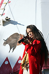 A young Native American Indian boy aiming a gun