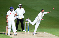 PICTURE BY VAUGHN RIDLEY/SWPIX.COM - Cricket - County Championship Div 2 - Yorkshire v Kent, Day 1 - Headingley, Leeds, England - 05/04/12 - Yorkshire's Adil Rashid bowls as Kent's Scott Newman looks on.