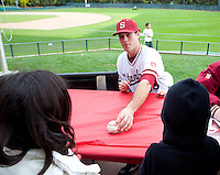 STANFORD, CA - March 27, 2011: Jordan Pries of Stanford baseball signs an autograph after Stanford's game against Long Beach State at Sunken Diamond. Stanford won 6-5.