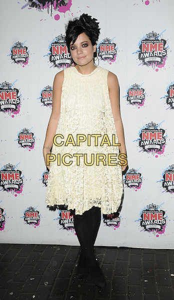 LILY ALLEN.The Shockwaves NME Awards 2010 held at Brixton Academy, London, England. .February 24th, 2010.full length white cream lace dress black tights sleeveless .CAP/CAN.©Can Nguyen/Capital Pictures.