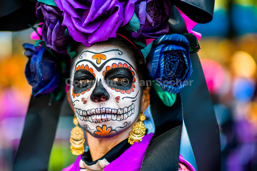 A young woman, dressed as La Catrina, a Mexican pop culture icon representing the Death, performs during the Day of the Dead festival in Mexico City, Mexico, 29 October 2016. Day of the Dead (Día de Muertos), a syncretic religious holiday combining the death veneration rituals of the ancient Aztec culture with the Catholic practice, is celebrated throughout all Mexico. Based on the belief that the souls of the departed may come back to this world on that day, people gather at the gravesites in cemeteries praying, drinking and playing music, to joyfully remember friends or family members who have died and to support their souls on the spiritual journey.