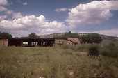 RGS Ridgway roundhouse and office building after abandonment.  No rolling stock is present.<br /> RGS  Ridgway, CO  ca. 1955