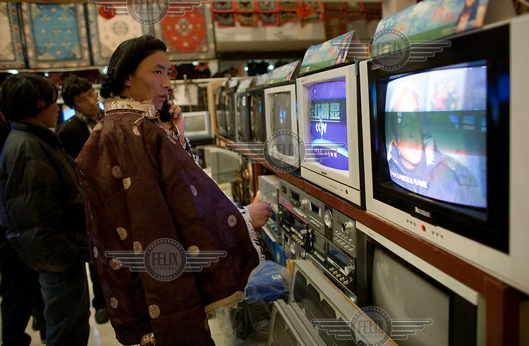 A man shops for a new television in a Lhasa shop.