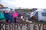 Massive damage at Wavecrest Caravan site in Caherdaniel pictured here on Monday alongside a caravan which was totally gutted were l-r; Brigid Murphy, Síofra O'Shea, John O'Shea, Bríd Moran & Desmond O'Shea.