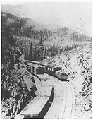 D&amp;RG construction trains on Marshall Pass in a deep cut.  This doesn't much look like Rio Grande: car markings and perhaps a strange-looking caboose next to the tie car.<br /> D&amp;RG  Marshall Pass, CO  Taken by Jackson, William Henry - ca. 1881