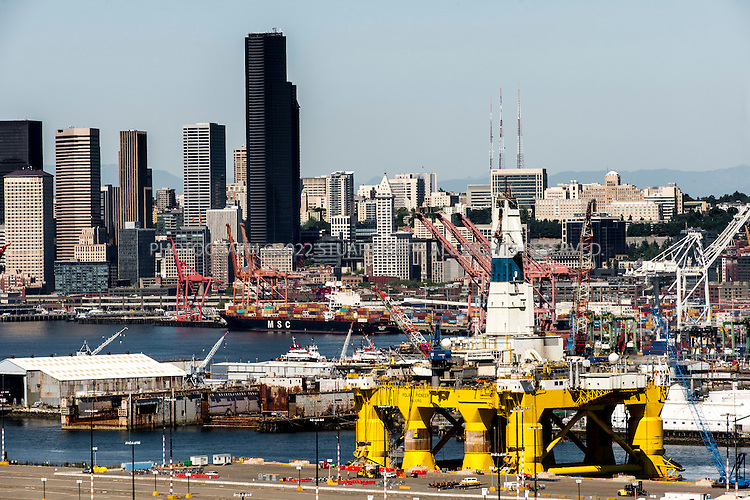 6/9/2015&mdash;Seattle, WA, USA<br /> <br /> The Polar Pioneer offshore oil rig, parked at Seattle&rsquo;s Terminal 5 at the Port of Seattle. The rig arrived in the city on May, 14th, 2015 and immediately drew protest groups as well as resistance from city, county and state leaders concerned over the rig&rsquo;s planned arctic oil exploration and the impact of arctic oil drilling on climate change. Shell hopes to berth equipment in Seattle during the off-season of oil exploration in Alaskan waters of the Arctic.<br /> <br /> When the Polar Pioneer arrived in Seattle it was met by activists paddling out in kayaks, so-called &ldquo;kayaktivists&rdquo;, who along with Greenpeace and other loosely aligned groups plans protests all summer in the city until the rig leaves.<br /> <br /> Photograph by Stuart Isett for The Wall Street Journal<br /> &copy;2015 Stuart Isett. All rights reserved.<br /> Slug: ARCTIBET