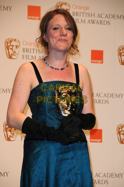 "EMMA LAZENBY.with the award for Best Short Animation for ""Mother of Many"".The Orange British Academy Film Awards 2010 at the Royal Opera House Covent Garden, London, England, UK,.February 21st, 2010 .press awards room pressroom BAFTA BAFTAs half length black  long sleeveless blue dress gloves winner award trophy necklace .CAP/CAS.©Bob Cass/Capital Pictures"