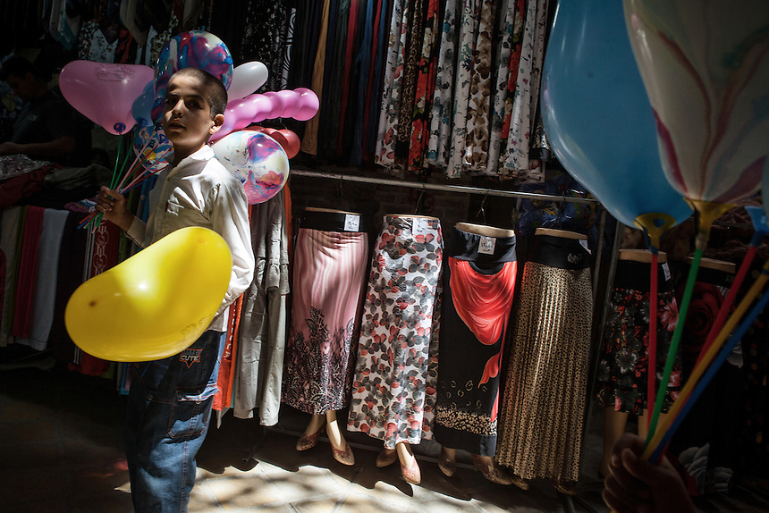Baloon seller at Yazd Bazaar. Yazd is one of the oldest living city in the world. Yazd was visited by Marco Polo in 1272, who described it as a good and noble city and remarked its silk production. The name Yazd means worship. And badgir is one of distinctive feature of this city.