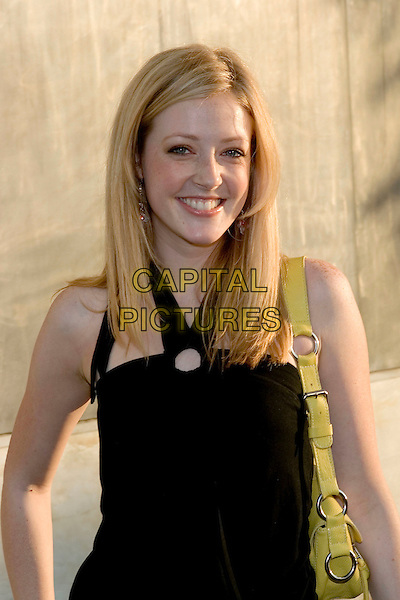 JENNIFER FINNIGAN.CBS Summer 2005 Press Tour Party Arrivals held at the Hammer Museum, Westwood, California.  .July 19th, 2005.Photo Credit: Zach Lipp/AdMedia.half length black top yellow purse strap.www.capitalpictures.com.sales@capitalpictures.com.© Capital Pictures.
