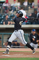 Francis Martinez (45) of the Missoula Osprey follows through on his swing against the Billings Mustangs at Dehler Park on August 21, 2017 in Billings, Montana.  The Osprey defeated the Mustangs 10-4.  (Brian Westerholt/Four Seam Images)