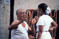 Middle aged man talking with a young woman in Santo Domingo, Dominican Republic