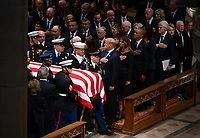 The flag-draped casket of former President George H.W. Bush is carried by a military honor guard past former President George W. Bush and wife Laura Bush, President Donald Trump, first lady Melania Trump, former President Barack Obama, Michelle Obama, former President Bill Clinton, former Secretary of State Hillary Clinton, former President Jimmy Carter, and Rosalynn Carter during a State Funeral at the National Cathedral, Wednesday, Dec. 5, 2018, in Washington. (AP Photo/Carolyn Kaster)