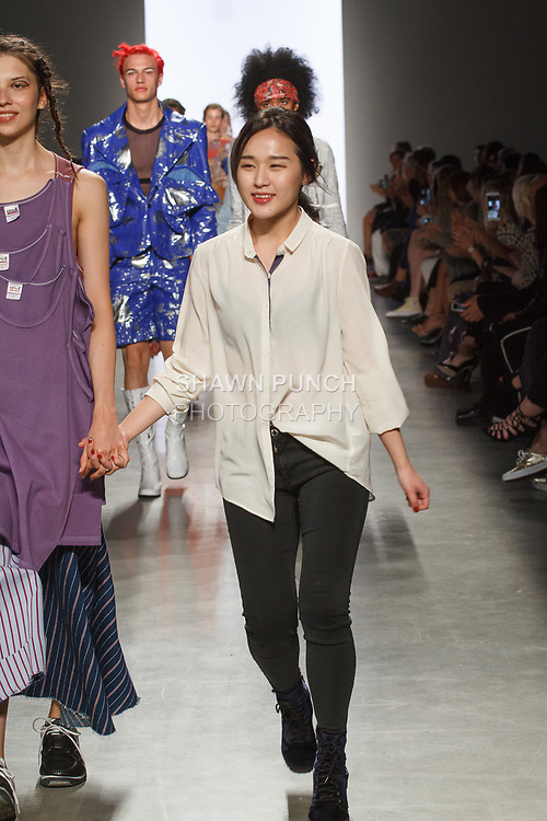 Graduating design student Regina Kim, walks runway with model at the close of 2017 Pratt fashion show on May 4, 2017 at Spring Studios in New York City.
