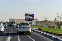 QATAR, Doha, religious complex with churches / KATAR, Doha, Religionskomplex mit Kirchen am Stadtrand, Parkplatz