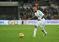 SWANSEA, WALES - JANUARY 17:   of  during the Barclays Premier League match between Swansea City and Chelsea at Liberty Stadium on January 17, 2015 in Swansea, Wales. Swansea's Dwight Tiendalli on the ball