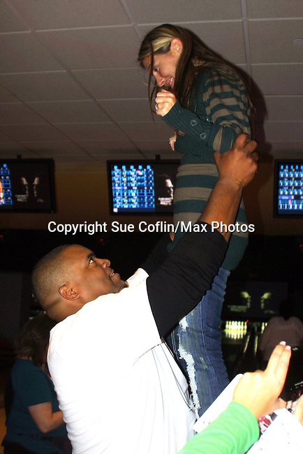 One Life To Live's Sean Ringgold picks up a fan at The Seventh Annual Daytime Stars and Strikes benefitting The American Cancer Society hosted by Elizabeth Keifer and Jerry VerDorn with actors from One Life To Live, All My Children, As The World Turns and Guiding Light on October 9, 2010 in New York City, New York. (Photo by Sue Coflin/Max Photos)