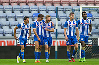 Wigan players celebrate Alex Gilbey of Wigan Athletic goal giving them a lead 1 0  during the pre season friendly match between Wigan Athletic and Liverpool at the DW Stadium, Wigan, England on 14 July 2017. Photo by Andy Rowland.