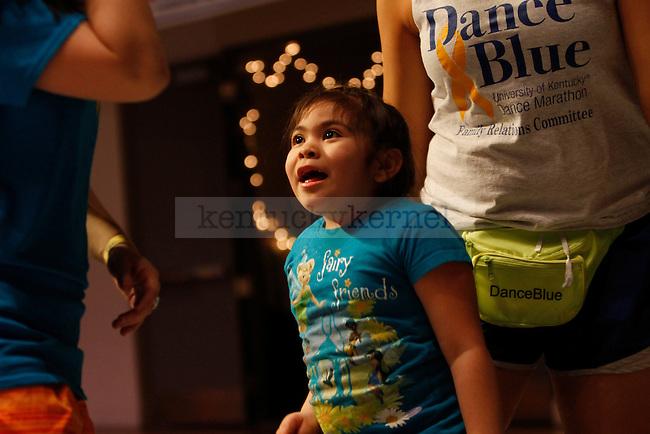 Yareli Gomez dances during DanceBlue, a 24 hour dance marathon to raise money for pediatric cancer research at Memorial Coliseum in Lexington, Ky. on Saturday, February 23, 2013. Photo by Genevieve Adams