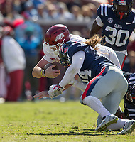 Hawgs Illustrated/BEN GOFF <br /> Cole Kelley, Arkansas quarterback, tries to takes a hit from Tayler Polk, Ole Miss lineacker, on a keeper in the third quarter Saturday, Oct. 28, 2017, at Vaught-Hemingway Stadium in Oxford, Miss.
