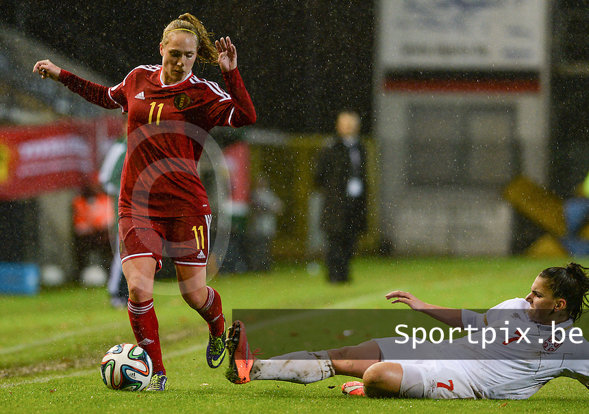 20151130 - LEUVEN ,  BELGIUM : Belgian Janice Cayman (left) pictured avoiding the tackle from Jovana Damnjanovic during the female soccer game between the Belgian Red Flames and Serbia , the third game in the qualification for the European Championship in The Netherlands 2017  , Monday 30 November 2015 at Stadion Den Dreef  in Leuven , Belgium. PHOTO DAVID CATRY