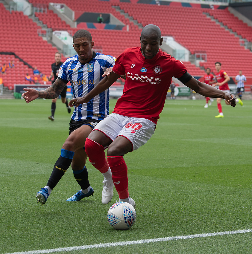 Sheffield Wednesday's Liam Palmer (left) vies for possession with Bristol City's Benik Afobe (right) <br /> <br /> Photographer David Horton/CameraSport<br /> <br /> The EFL Sky Bet Championship - Bristol City v Sheffield Wednesday - Sunday 28th June 2020 - Ashton Gate Stadium - Bristol <br /> <br /> World Copyright © 2020 CameraSport. All rights reserved. 43 Linden Ave. Countesthorpe. Leicester. England. LE8 5PG - Tel: +44 (0) 116 277 4147 - admin@camerasport.com - www.camerasport.com