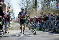 Yauheni Hutarovich (BLR/Bretagne - S&eacute;ch&eacute; Environnement) comes running out of <br /> sector 18: Trou&eacute;e d'Arenberg - Wallers Forest with a completely smashed front wheel<br /> <br /> 113th Paris-Roubaix 2015