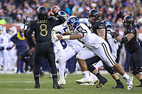 Philadelphia, PA - December 8, 2018:   Navy Midshipmen defensive end Jarvis Polu (90) pressures Army Black Knights quarterback Kelvin Hopkins Jr. (8) during the 119th game between Army vs Navy at Lincoln Financial Field in Philadelphia, PA. (Photo by Elliott Brown/Media Images International)