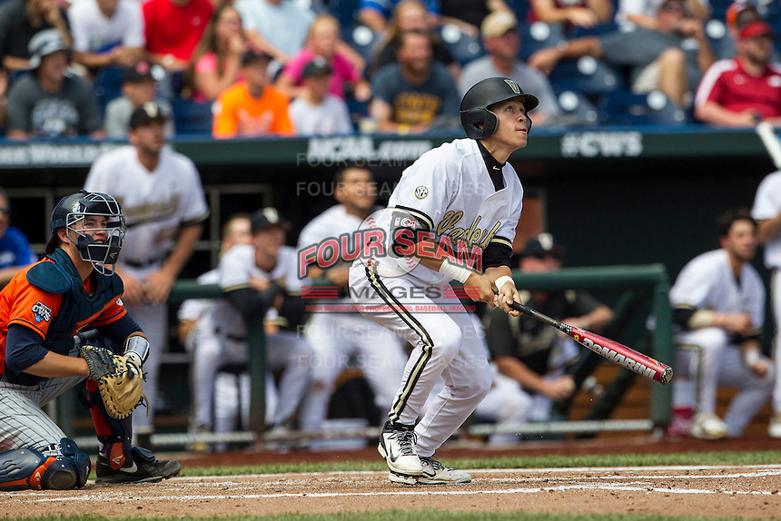 Vanderbilt Commodores outfielder Jeren Kendall (3) delivers a walk off 2 run home run during the NCAA College baseball World Series against the Cal State Fullerton Titans on June 15, 2015 at TD Ameritrade Park in Omaha, Nebraska. Vanderbilt beat Cal State Fullerton 4-3. (Andrew Woolley/Four Seam Images)