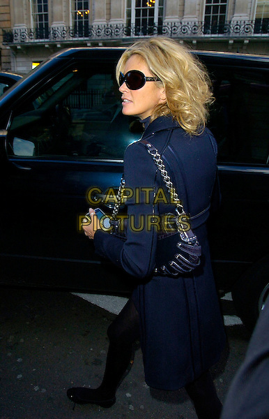 ELLE MacPHERSON.The Old Vic Theatre Fundraiser VIP lunch, 50 St. James restaurant, London, UK..November 21st, 2006.full length car sunglasses shades bags goody black bag purse blue coat.CAP/CAN.©Can Nguyen/Capital Pictures