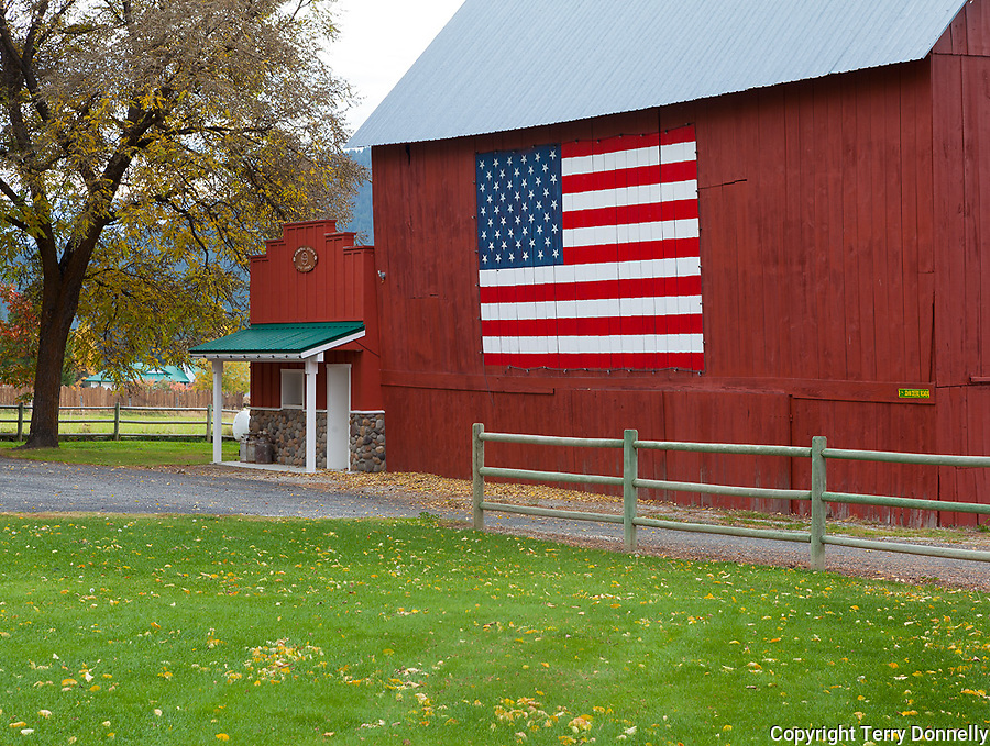 Chelan County, Washington:<br /> Historic red barm with an American flag painted on the side
