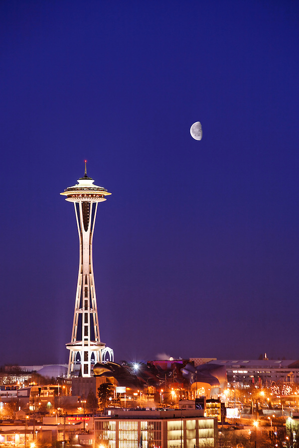 The Seattle Space Needle stands under a quarter moon in a twilight sky, Seattle, Washington, USA