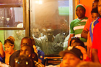 New York, NY -  Saturday, June 14, 2014: Ivory Coast fans watch Ivory Coast vs. Japan first round World Cup match at the New Ivorie Restaurant in New York City.