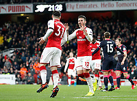 GOAL - Olivier Giroud of Arsenal celebrates scoring during the Premier League match between Arsenal and Huddersfield Town at the Emirates Stadium, London, England on 29 November 2017. Photo by Carlton Myrie / PRiME Media Images.