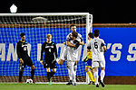GREENSBORO, NC - DECEMBER 02: Justin Brautigam #21 of Messiah College celebrates with teammates after scoring a goal against North Park University during the Division III Men's Soccer Championship held at UNC Greensboro Soccer Stadium on December 2, 2017 in Greensboro, North Carolina. Messiah College defeated North Park University 2-1 to win the national title. (Photo by Grant Halverson/NCAA Photos via Getty Images)