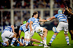 September 29, 2018. Jose Amalfitani, Buenos Aires, Argentina. Tomas Cubelli kicks the ball under protection of Tomas Lavanini during second half of the match.