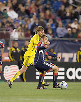 New England Revolution midfielder Michael Videira (19) controls the ball as Columbus Crew forward/midfielder Eddie Gaven (12) defends. The Columbus Crew defeated the New England Revolution, 1-0, at Gillette Stadium on October 10, 2009.