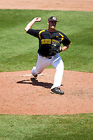 Cale Elam (4) of the Wichita State Shockers delivers a pitch during a game against the Missouri State Bears in the 2012 Missouri Valley Conference Championship Tournament at Hammons Field on May 23, 2012 in Springfield, Missouri. (David Welker/Four Seam Images)