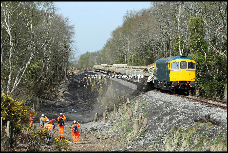 BNPS.co.uk (01202 558833)<br /> Pic: AndrewWright/BNPS<br /> <br /> East of Furzebrook, April 2015.<br /> <br /> A public train service is to run on a railway line ripped up in the 'Beeching Axe' thanks to an army of volunteers who have spent 45 years painstakingly rebuilding it. <br /> <br /> From next month timetabled passenger trains will operate on a daily basis from the mainline down to Swanage in Dorset.<br /> <br /> The Victorian town was effectively cut off from the rail network in 1972 after Dr Richard Beeching, a government railway advisor, recommended it be one of hundreds of loss-making rural lines axed.<br /> <br /> Since then hundreds of people have restored the track which has been upgraded to meet today's safety standards.