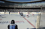 OMAHA, NE - FEBRUARY 9:  The opening face off as the Lincoln Stars take on the Omaha Lancers at the Battle on Ice Saturday at TD Ameritrade in Omaha, NE. This was the first game in USHL history to be played outside. The Lancers defeated the Stars 4-2. (Photo by Dave Eggen/Inertia)