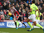 Billy Sharp of Sheffield Utd leaps up to control the ball during the English League One match at Bramall Lane Stadium, Sheffield. Picture date: December 31st, 2016. Pic Simon Bellis/Sportimage
