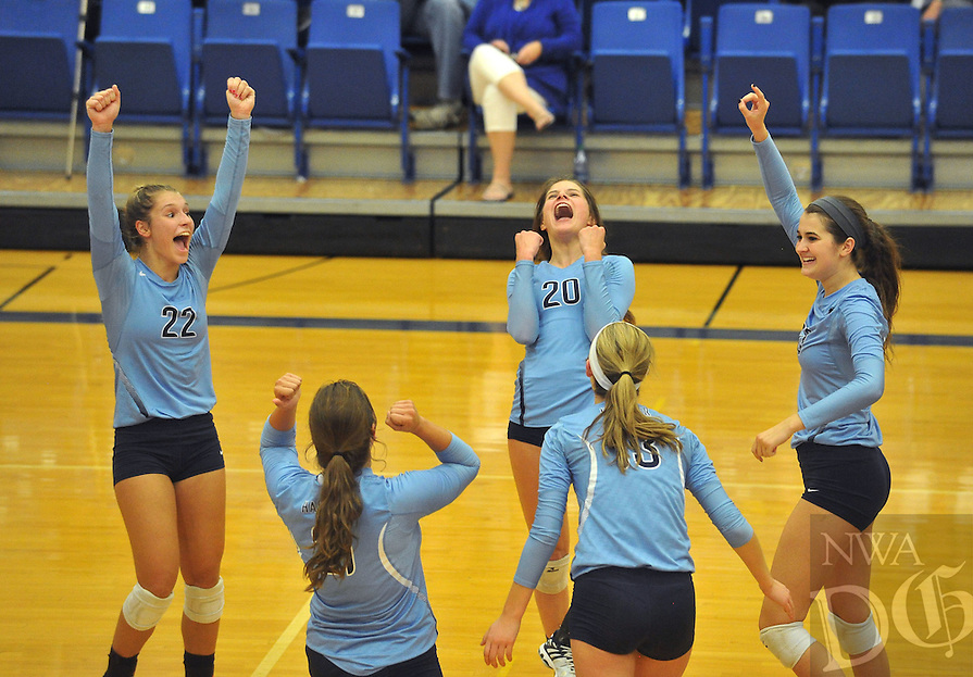 NWA Democrat-Gazette/MICHAEL WOODS &bull; @NWAMICHAELW<br /> Har-Ber players Klaire Trainor (22) Lauren Thompson (20) Emily Thompson (23) Elizabeth Williams (13) and Paige Williams (21) celebrate after beating Rogers in the second set of their game Thursday October 15, 2015 in Rogers.