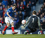 Andy Little is one on one with Peterhead keeper Mark McCallum who manages to pull off a save