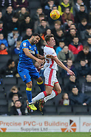 Andy Barcham of AFC Wimbledon and Callum Brittain of MK Dons in an aerial battle during the Sky Bet League 1 match between MK Dons and AFC Wimbledon at stadium:mk, Milton Keynes, England on 13 January 2018. Photo by David Horn.