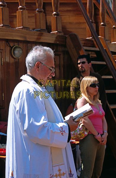 Priest on deck blessing The Karaka galleon moored in the Old City Port, Dubrovnik, Dalmatian Coast, Croatia, Former Yugoslavia