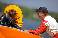 "Dan Kanfoush, Y-1 ""Fast Eddie Too"" talks with competitor Sean Bowsher Y-52 as he works on his boat.  (1 Litre MOD hydroplane(s)"